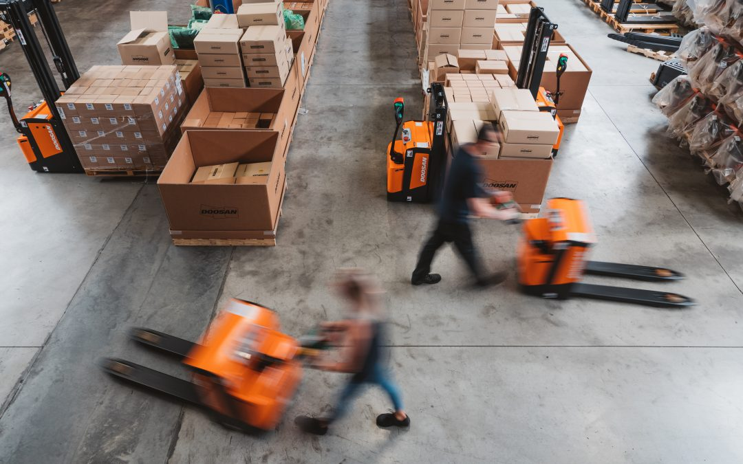 Powered Pallet Truck Buying Guide – Walkie vs Platform